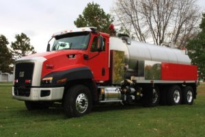 Full view of Osco Tank and Truck Sales Fusion Series Vacuum Tanker with red cab and stainless steel tank.