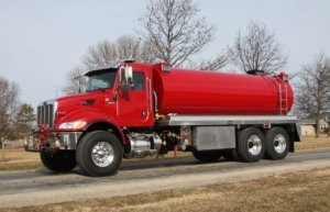 Red tanker truck with red tank facing left