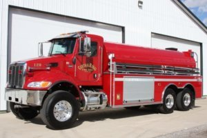 Full body view of red tanker fire truck