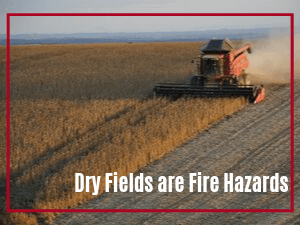 Combine harvesting corn as featured image with wording Dry Fields are Fire Hazards overlaid