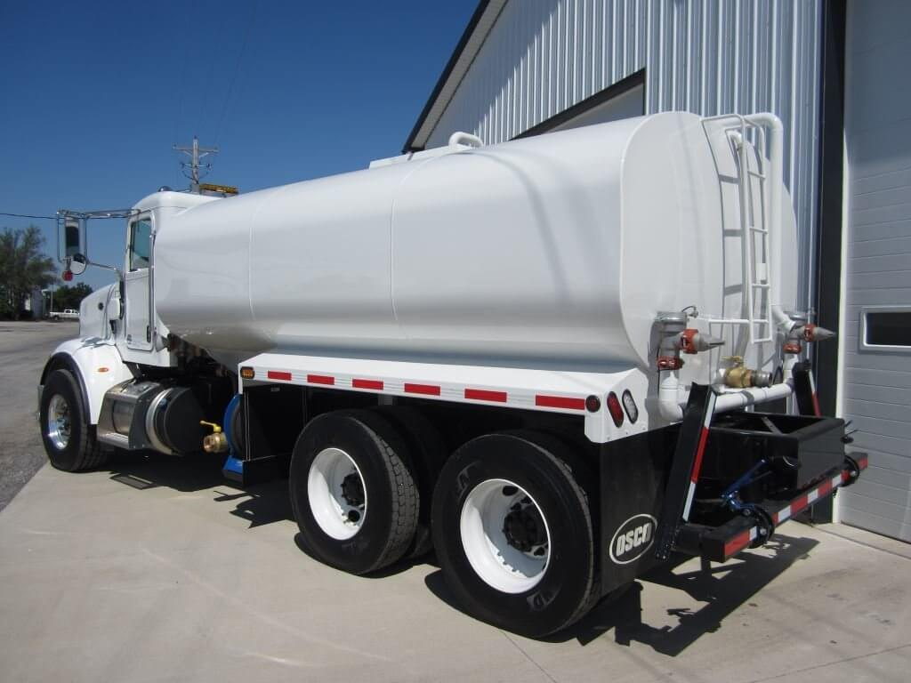 White bodied Osco Tank & Truck Sales water truck