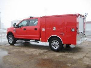 Full vehicle view of red responder truck built by Osco Tank & Truck Sales