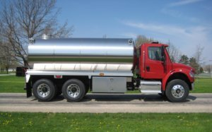 Osco Tank and Truck Sales Commander fire tank truck with a red cab and stainless steel tank