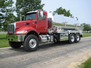 Osco Tank and Truck Sales Fusion Vacuum Tender with red cab and silver tank