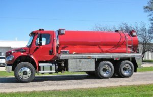 Osco Tank and Truck Sales Commander truck with red cab and tank